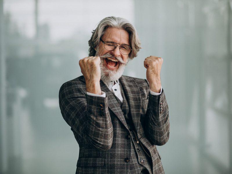Senior Business Man Showing Emotions